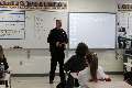 school resource officer speaking with students