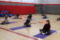 students participating in yoga exercise