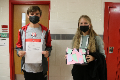 students holding up positivity project activity materials