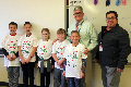 students and principal and food services manager