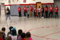 educators holding letters that spell enthusiasm