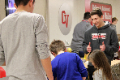 students taking part in steam night activity station