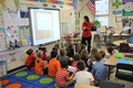 olivia wahl standing talks to second grade students sitting