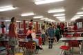 students walking through trashion show