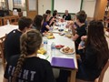 table of students eating lunch and talking with superintendent