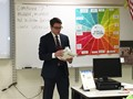 man talking to classroom