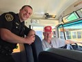sheriffs deputy on bus with driver