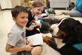 students read to Benny the therapy dog