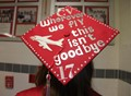 photo of graduation cap reading c v where we fly this isn't goodbye