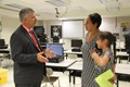 mister krause talks to parent and student at middle school open house