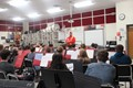 veteran speaking with band students