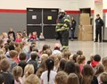 students watching fire safety assembly