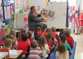 district attorney reading to kindergarten students