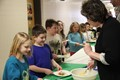 teachers serving students taco ingredients