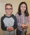 students holding coins