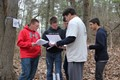 students outdoors participating in envirothon