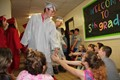 seniors give elementary students high fives