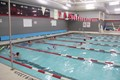 wide shot of students swimming in pool
