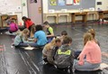 students working in groups on map