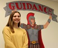 Katerina Retzlaff standing next to guidance sign