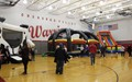 wide shot of community night activities in gymnasium
