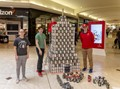 c v students next to their canstruction structure
