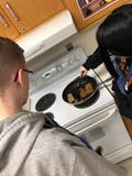 students frying scrapple