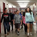 students walking in hallway