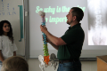 presenter showing students model of spine