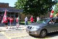 teachers waving to car going through parade