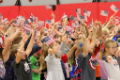 students waving flags
