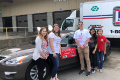 sadd members and advisors next to post prom event giveaway car