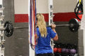 student lifting weight