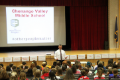principal attleson speaking with students at Positivity Project kick off assembly