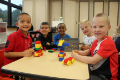 students playing with building blocks