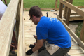 student helping to build ramp