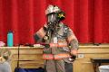 person wearing firefighter uniform