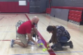 student helping teacher