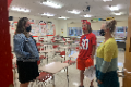 student and family member talking with teacher at open house