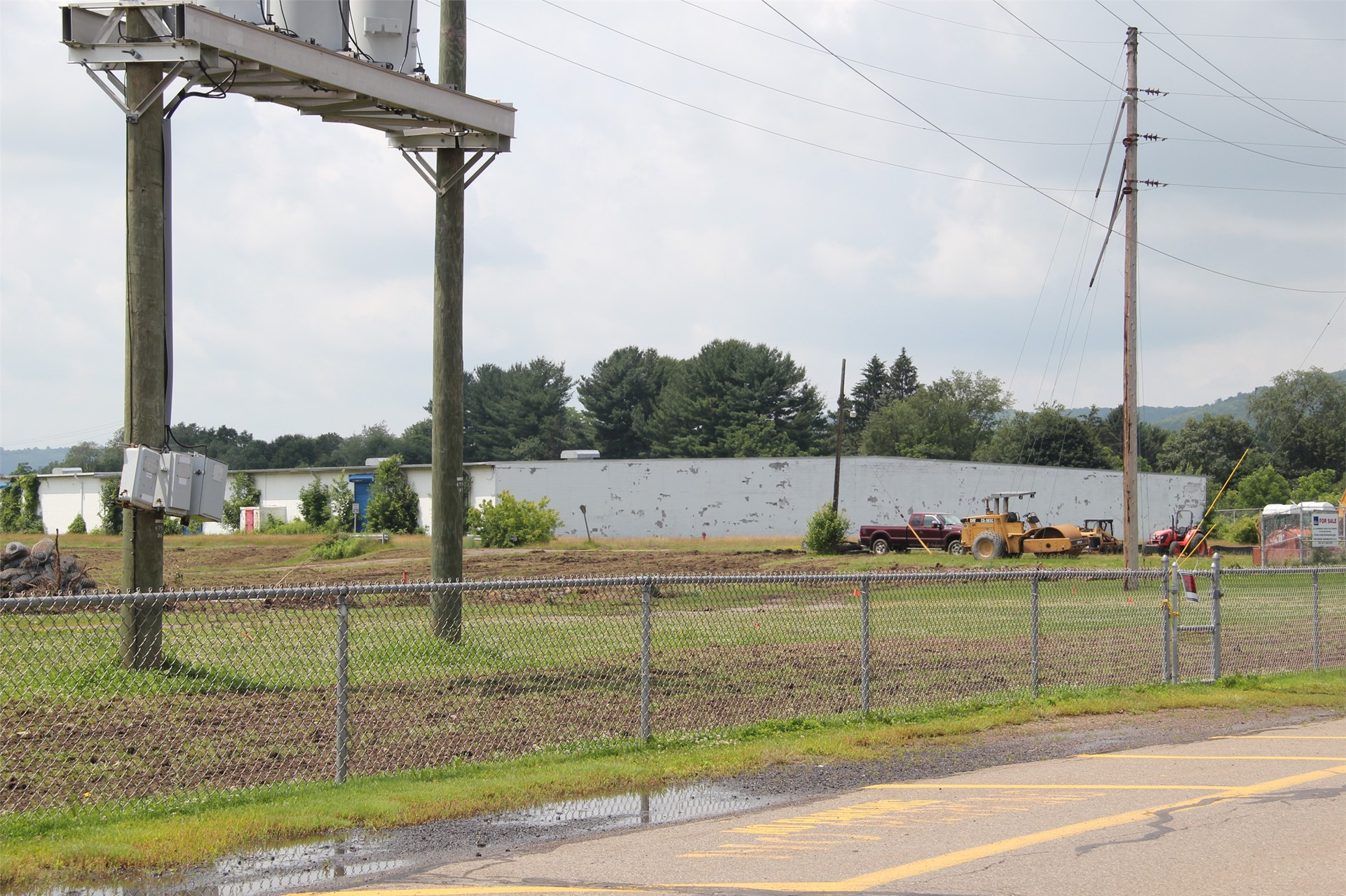 wide shot of construction scene outdoors at field