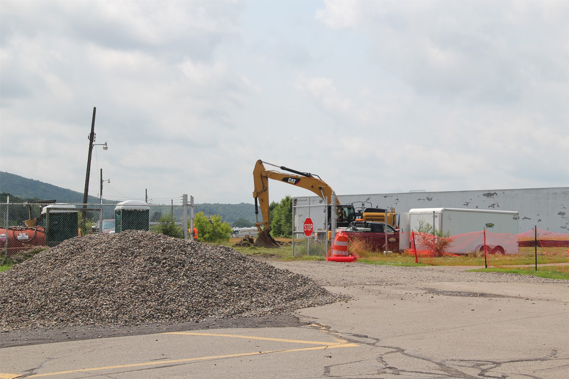 wide shot of crane at construction scene outdoors at field
