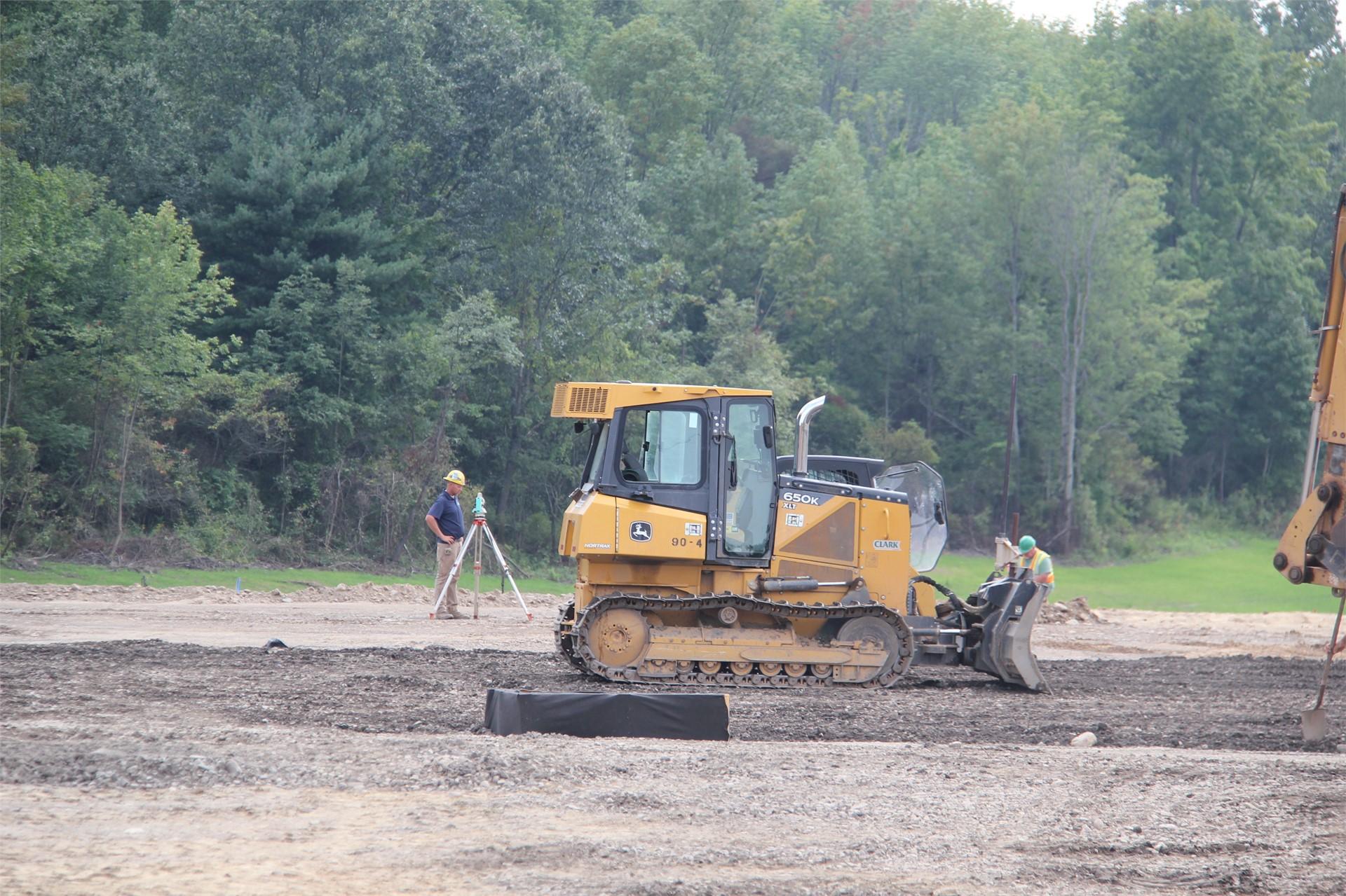 medium shot of equipment working on construction outside