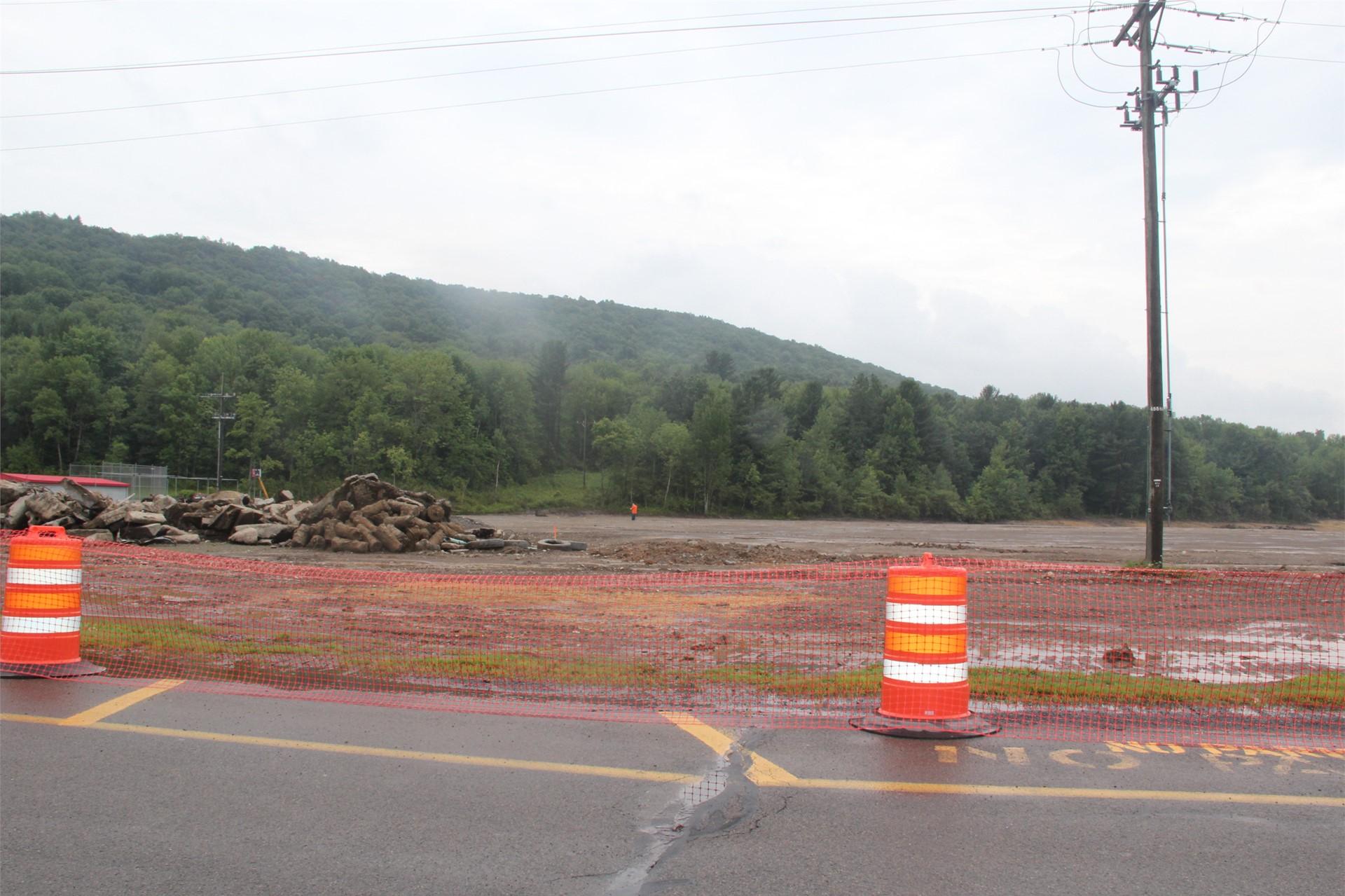 wide shot of cones in front of construction scene field