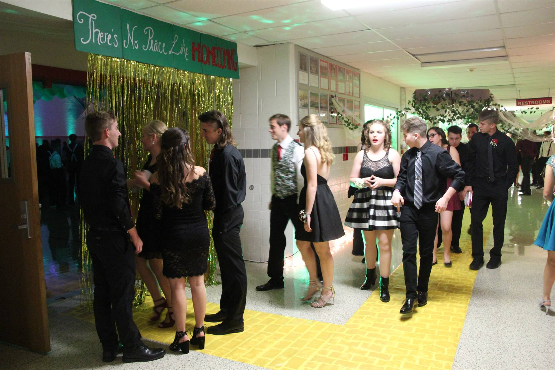 students in the high school hallway going into homecoming dance