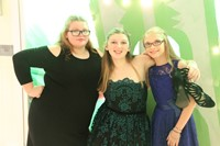 three female students smile for picture at homecoming