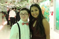 male and female student smile for a picture at homecoming dance