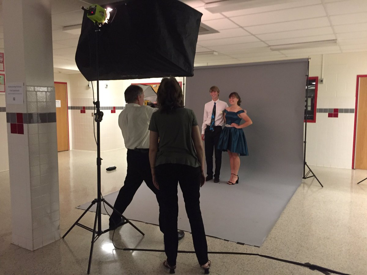 the kunkels take professional photos of students at homecoming dance