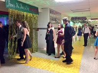 students walking into homecoming dance.