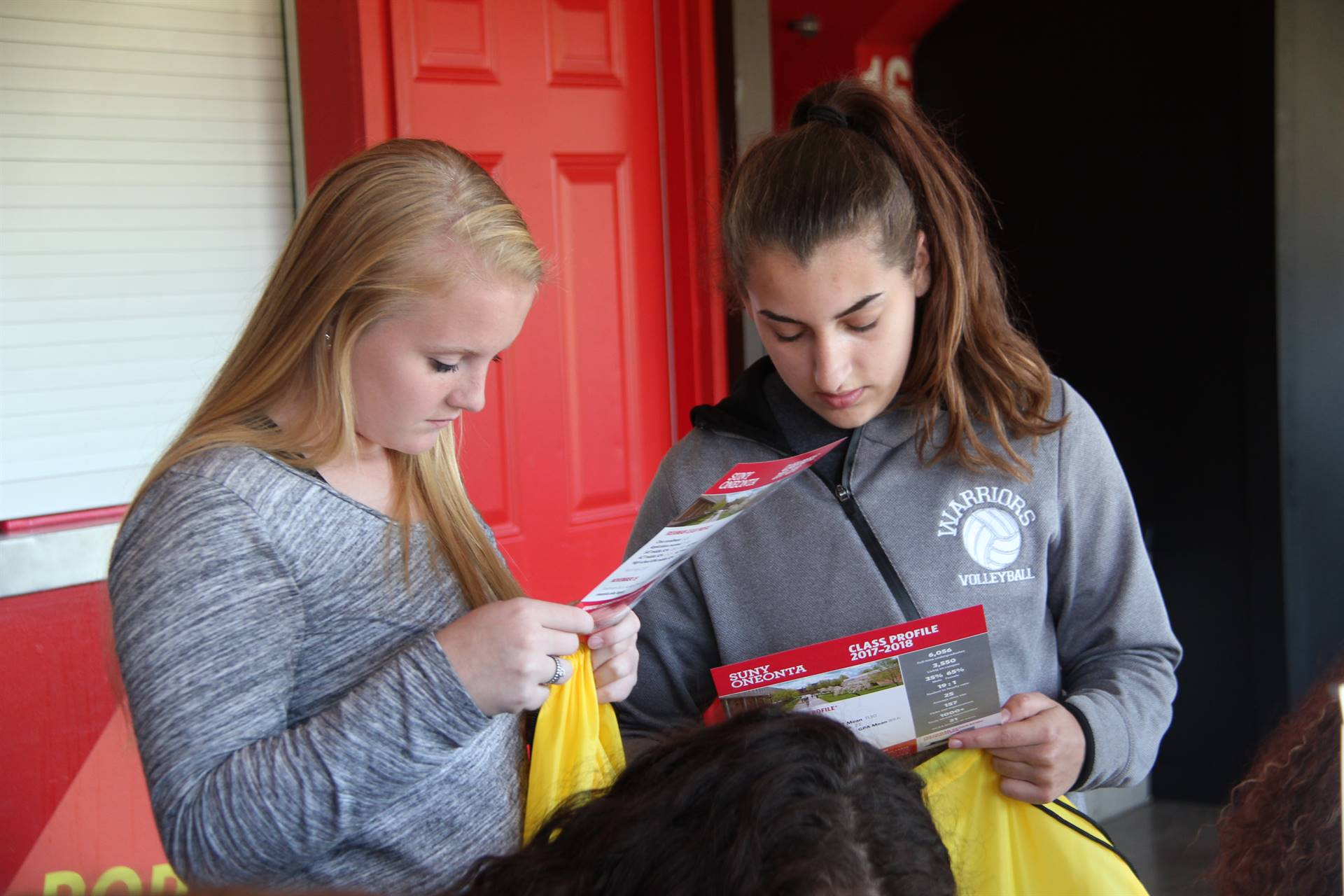 chenango valley high school students look at college pamphlets