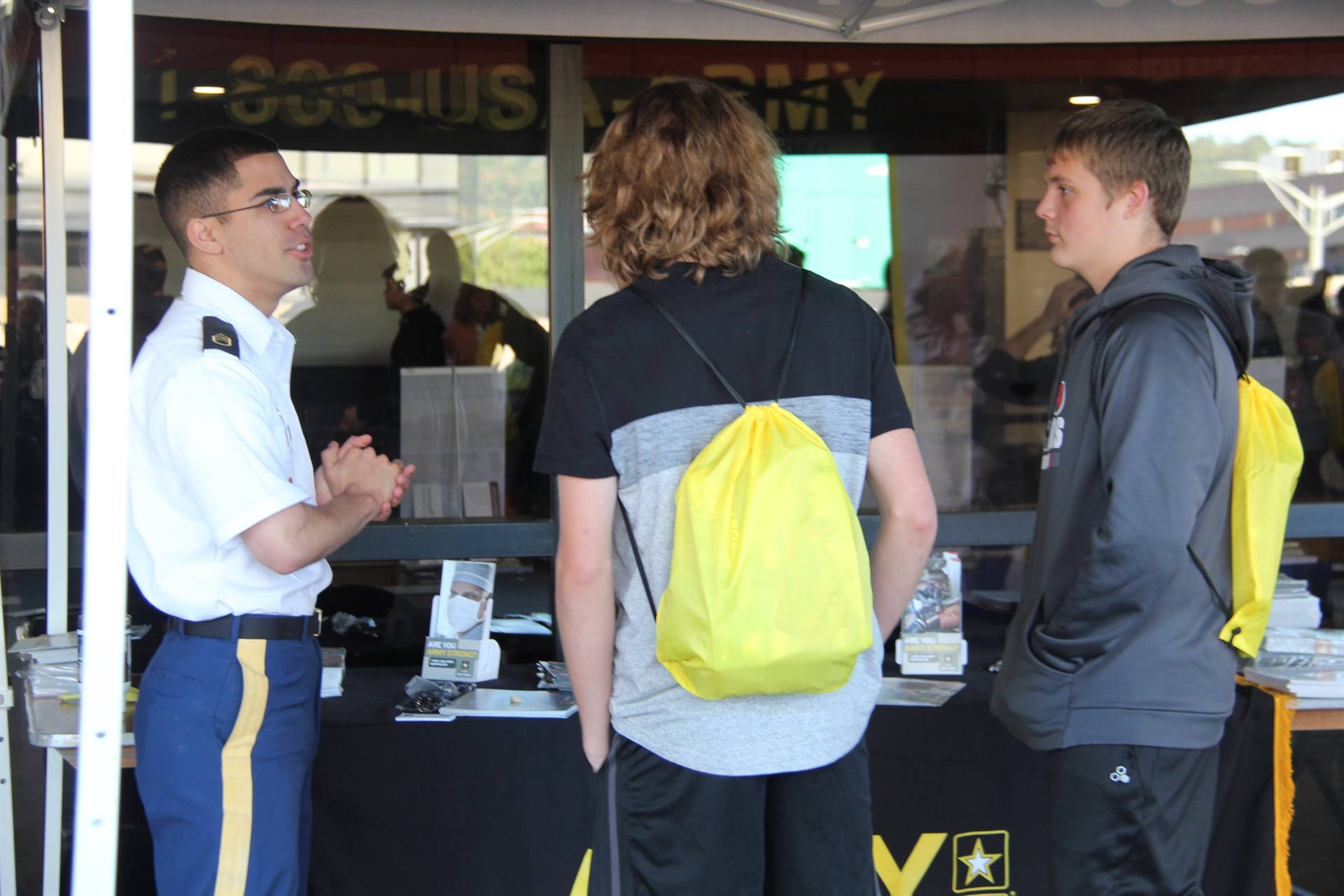chenango valley high school students talk to military representative at college day